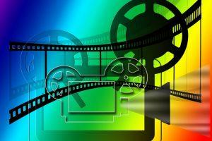 Rainbow colored icon of movie reel.