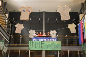 Phi Theta Kappa members standing with their #MeToo display in Gaiser hall. Theresa Matthiesen/The Indy