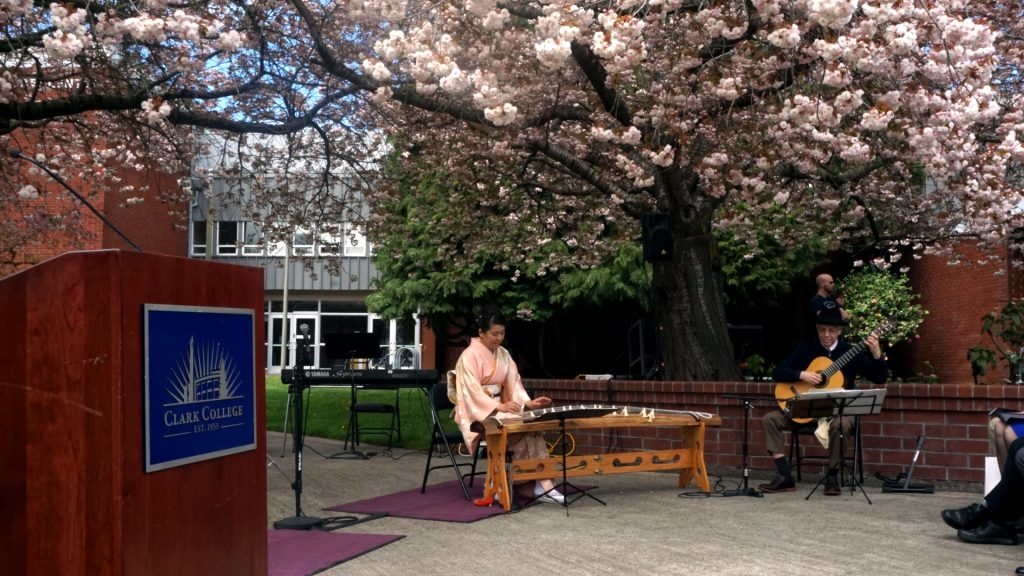 Yukiko Vossen (left) and Peter Size (right) add ambient music composed with a Koto and classical Guitar. (Tyler Reyes/The Indy)