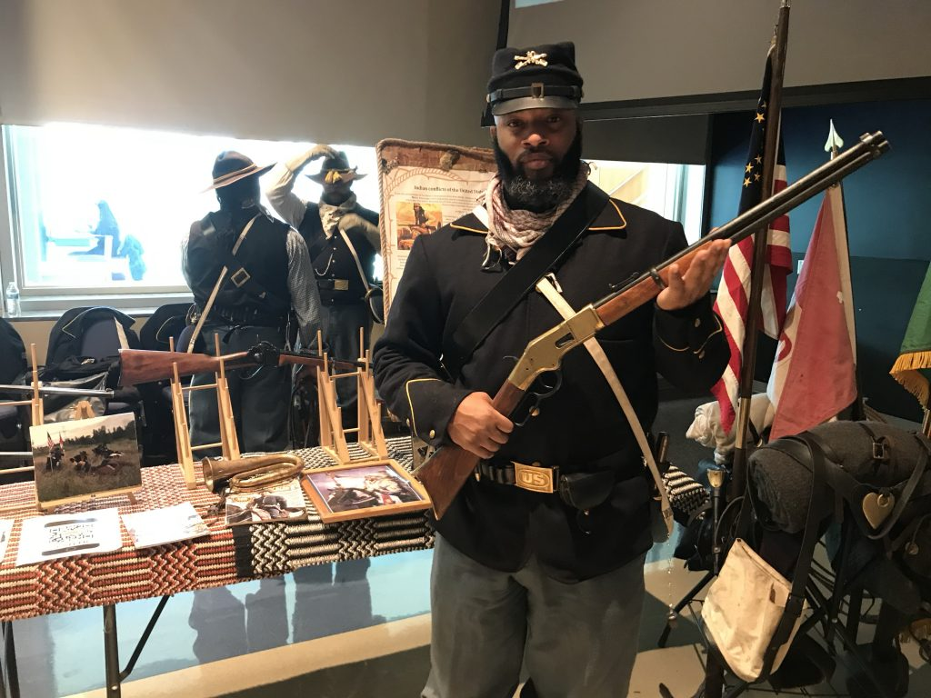 Nick Brooks holding a Henry Repeater rifle.