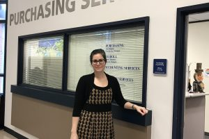 Natalie Guillen standing in front of Purchasing Services office