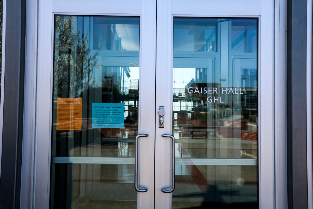 Doors to Gaiser Hall closed with signs for school closure