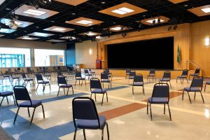 picture of chairs spaced six feet apart in student center