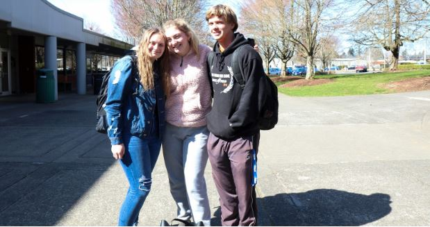 Classmates Haven Davis, Hannah Runyon, and Tyrel Halme pose for a photo outside Hanna Hall.