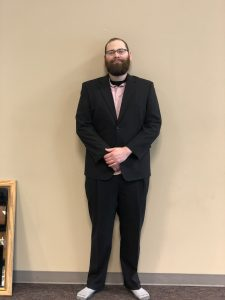 James Pyland dressed in a suite