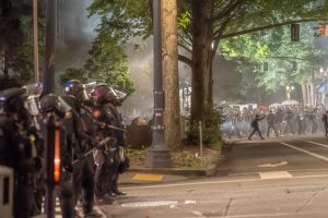 Law enforcement officers clear Chapman Square of protesters with tear gas and a tactic called a baton charge, where officers run towards protesters then form a line, on June 5 (Matt Fields/The Indy)