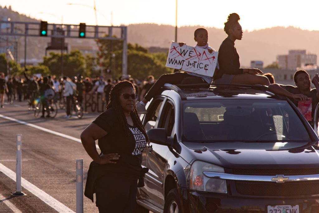 While the majority of people marched in the streets, supporters also parked along the route or held signs from balconies in solidarity.(Matt Fields/The Indy)