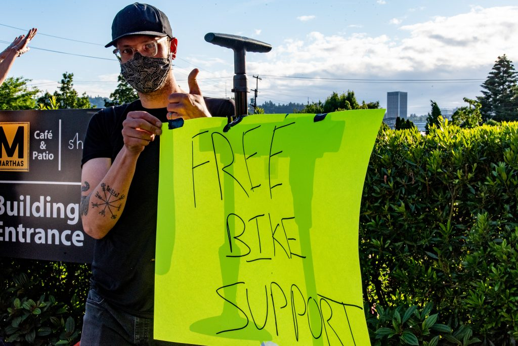 Portland resident Tom offers bike support for the many protesters on two wheels. Tuesday June 2.(Matt Fields/The Indy)