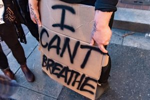 Taylor, a Vancouver Washington Resident, Holds her sign while protesting on June 2 at Pioneer Square. (Matt Fields/The Indy)