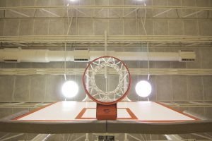 Close up of basket ball hoop in a gym.