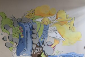 """A photo of the new mural that is now in Cannell Library, The mural is a student work and titled """"Nature of Change""""."""