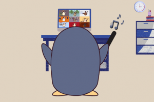 A penguin sits in front of a laptop leading a virtual choir session over Zoom.